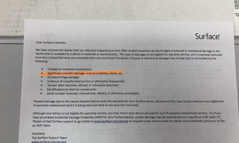 """The letter about the """"cosmetic damage"""". It voids the warranty, and we can't use it to replace the battery"""